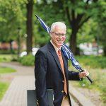 President Rosenberg holding an umbrella