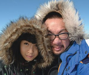 Photo of Bao Phi and his daughter
