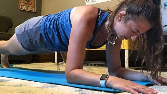 Photo of Kayla Togneri doing a plank exercise