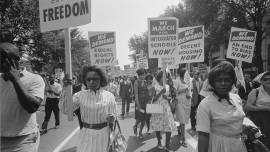 Black and white photo of a march for civil rights