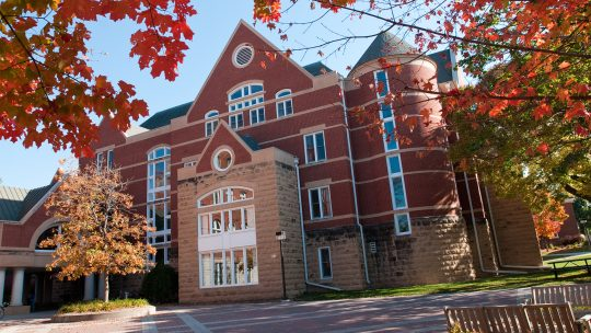 DeWitt Wallace Library on the Macalester campus in fall.