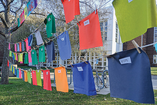 Photo of a clothesline with pieces of fabric clipped to it