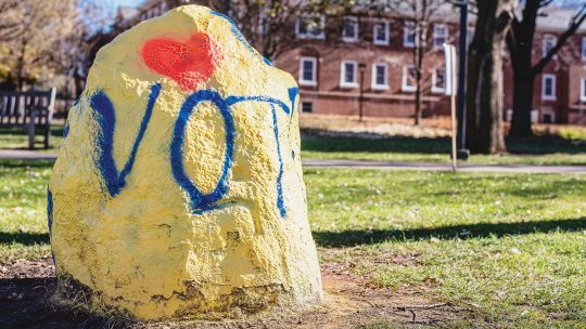 Photo of the Macalester Rock painted to read VOTE