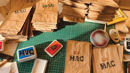 Photo of paper bags stamped with GO MAC