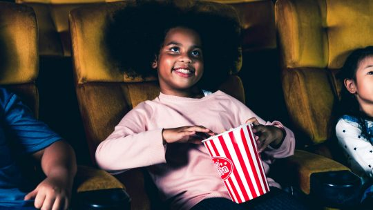 Photo of a child eating popcorn
