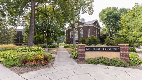 Photo of the Macalester College sign in front of campus.
