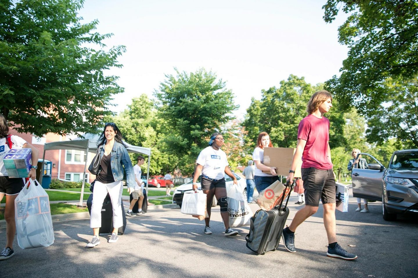 Photo of students moving into a residence hall on campus.
