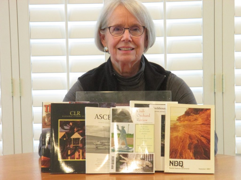 "The only way I could think of to visually demonstrate my essay writing is with the attached photo of me with literary journals and anthologies in which my essays have been published. One journal, Crab Orchard Review at Southern Illinois University, awarded me a literary nonfiction prize for my essay, ""Flight from Hungary,"" about my family's escape from the country after WWII. The essay is the basis of my book-length memoir, Becoming Hungarian, which is slated to be published She Writes Press, a hybrid publisher of female authors, in 2021. <br> Submitted by: Erika Reich Giles"