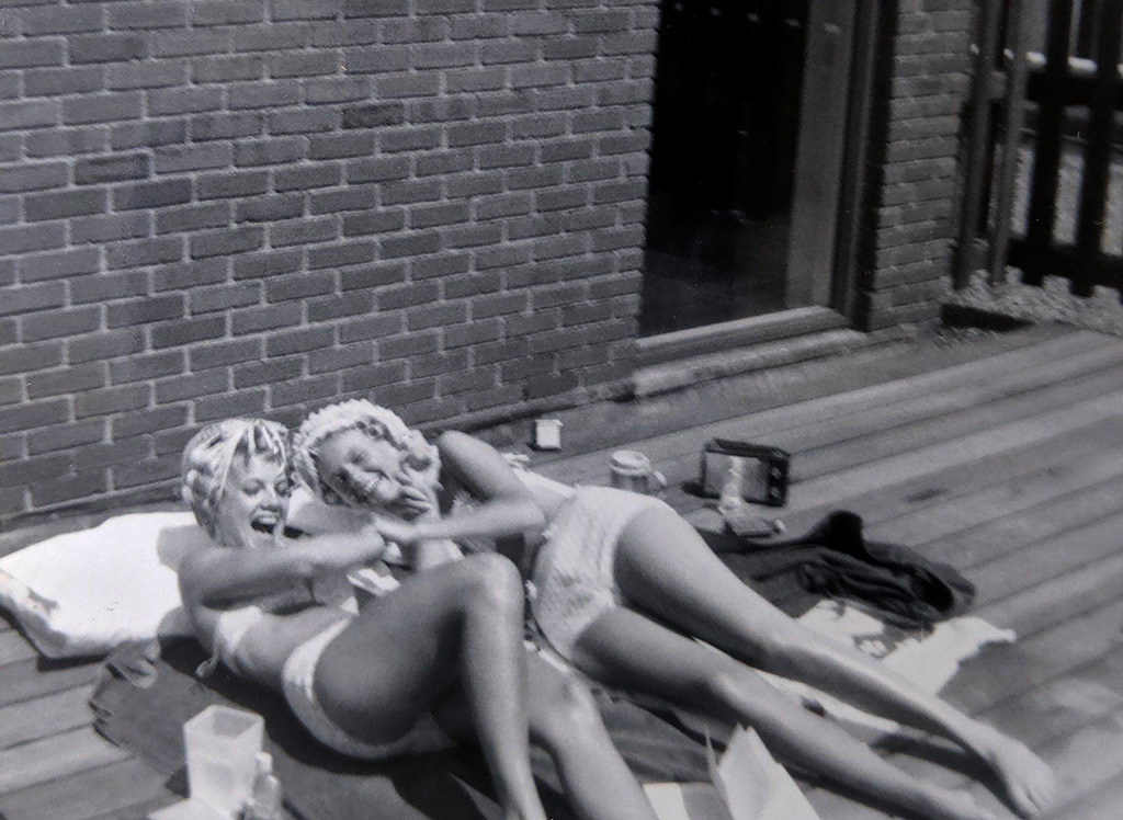 Alayna Carlson and Liz Kiesow Aase – sunbathing on the roof of Doty.<br> Submitted by: Julie Schlueter