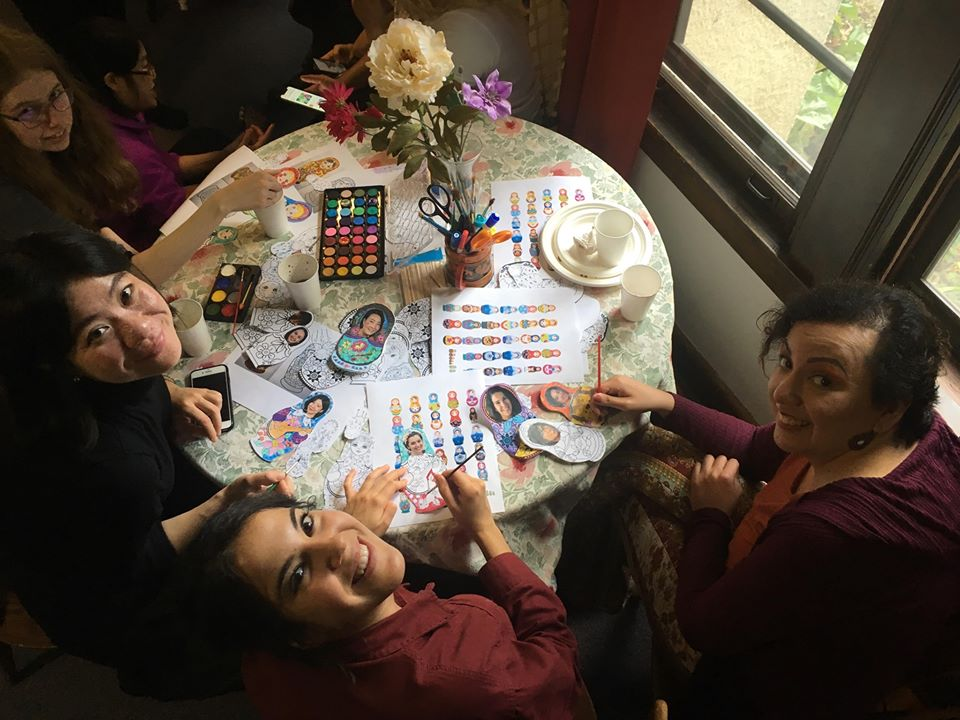 Students and faculty paint matroyshka selfies at the Russian House 2019 welcome party