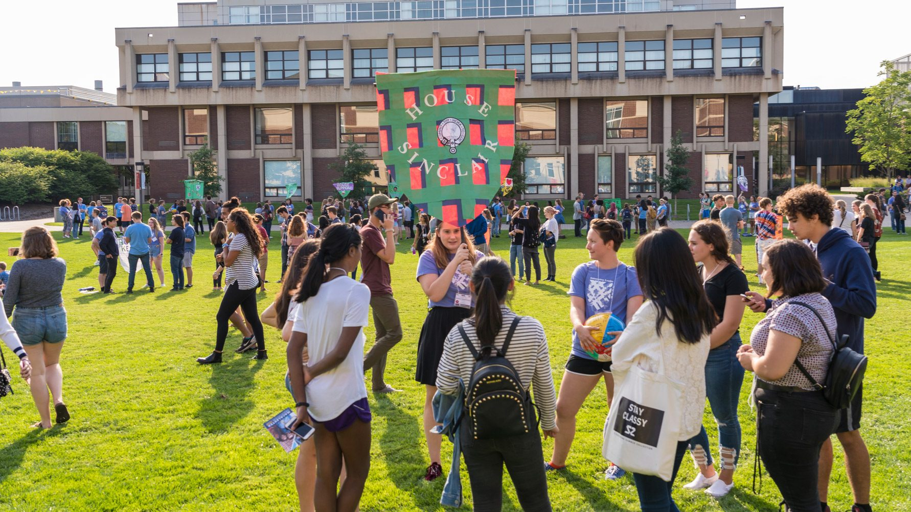 Students gathering on Shaw Field for Orientation