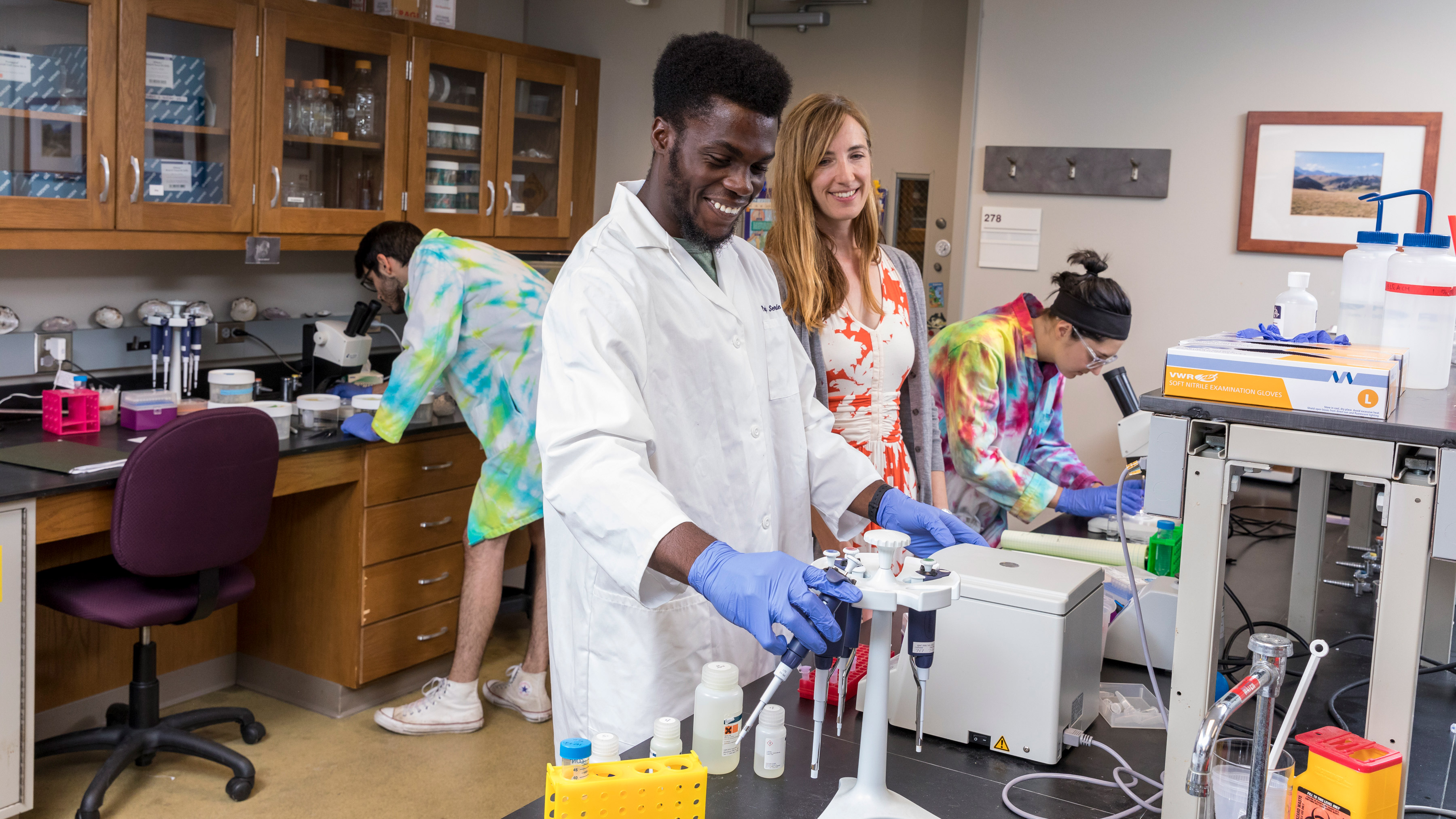 Photo of students working in a science lab.