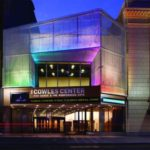 The Cowles Center lit with multicolored lights