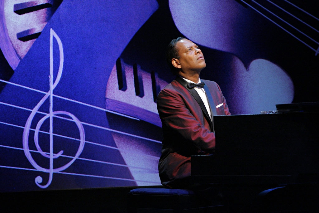 Dennis W. Spears (Nat Cole) in the Penumbra Theatre production of I Wish You love by Dominic Taylor, at Penumbra Theatre April 21 – May 22, 2011. Directed by Lou Bellamy, scenic design by Lance Brockman, costume design by Mathew J. LeFebvre, lighting design by Don Darnutzer.