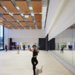 Several performers rehearsing in a dance studio