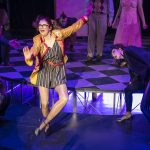 Columbia from Rocky Horror tap dancing on stage
