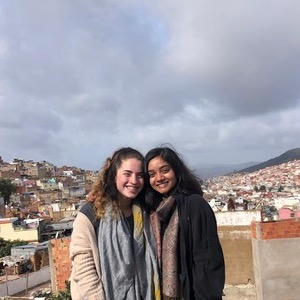 Mina and a friend in front of the Granada skyline