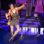 Actor portraying Columbia in Rocky Horror tap dancing on stage