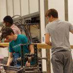 Three students working in the scene shop