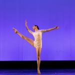 Ballet dancer lifting her leg on stage