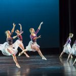 Ballet dancers leaping on stage