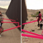 Pink seesaws through the border wall