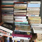 stacks of books in APBP's office