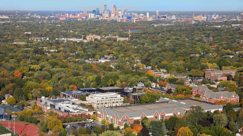 Aerial photo with the Macalester campus in the foreground and downtown in the background.